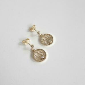 14 krt. gouden oorstekers € 565,00